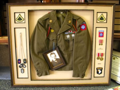 Medals, photo, and military uniform.